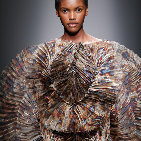 Iris van Herpen creates dresses from circles of lustrous metal gauze