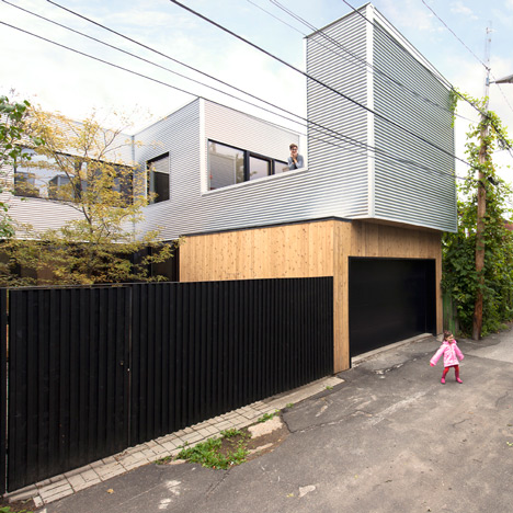 Montreal home updated with corrugated metal cladding and a vibrant staircase