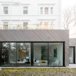 Claridge Architects inserts timber-clad house behind north London mansion block
