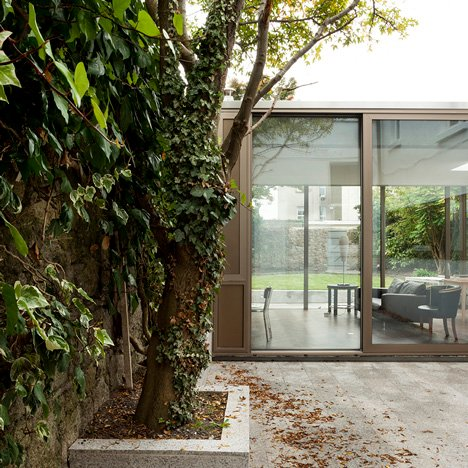 "Glazed house extension by GKMP Architects ""feels like part of the garden"""