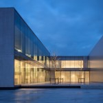 Govaert & Vanhoutte creates concrete and glass headquarters for door manufacturer Rob Systems