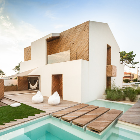 SilverWoodHouse-by-Ernesto-Pereira_dezeen_sq