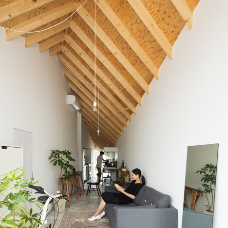 House and art studio by Alphaville features a diamond-shaped plan and a pointed roof