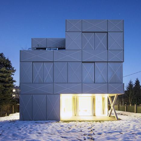 Ofis arhitekti adds grid of crosses to facade of ljubljana for Ofis arhitekti