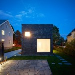 Villa Wot is a brick cuboid punctured by different-sized windows