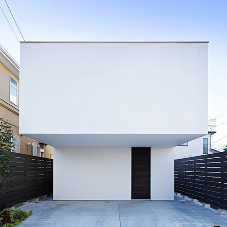 Wave is a surfer's house with a protruding windowless facade and a secret courtyard
