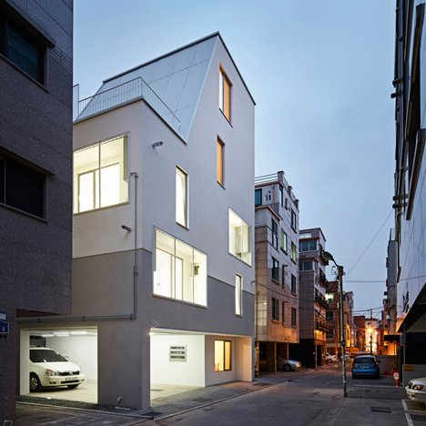 White Cone House creates daylit homes on a restricted Seoul site