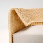 Rattan backrest curves around Hiroomi Tahara's Wrap sofa