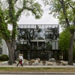 5468796 Architecture covers apartment building in reflective panels of glazing