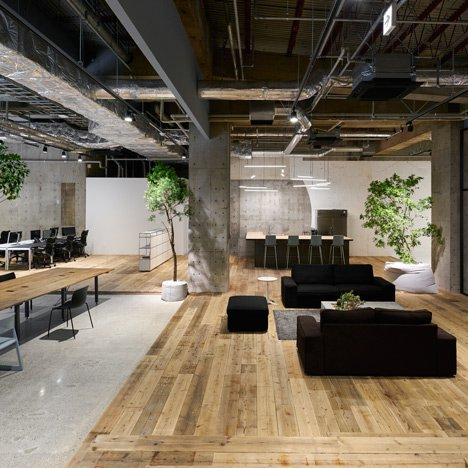 Torafu Architects uses concrete, wood and gravel to define spaces inside AKQA's Tokyo offices