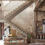 BEL Architecten leaves rough surfaces on show in warehouse converted into a cultural centre