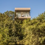 Casa 367 sits above the treetops of a hillside in Argentina