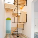 Sculptural staircase connects two mosaic floors in an old fisherman's cottage in Sicily