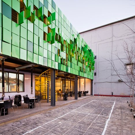 Folding green panels animate facade of Forest House restaurant by JYA-rchitects