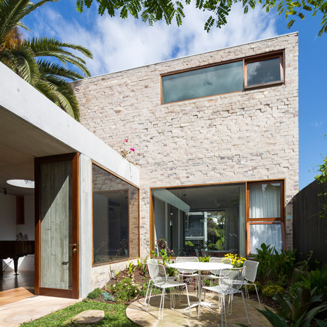 Textured brick and concrete house in Sydney encloses a garden courtyard