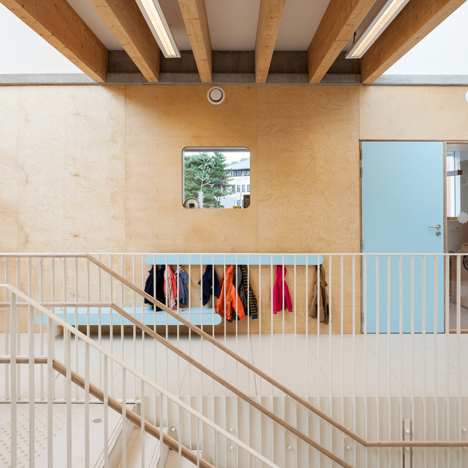 Daycare centre near Brussels features child-size furniture and a combined staircase and slide