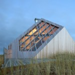 Beach house by Marc Koehler Architects is half submerged into a grassy dune