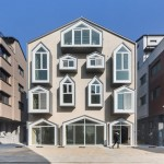 Gablepack by AND features a facade of house-shaped windows