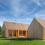 House in rural Germany features a slatted wooden facade and copper fittings