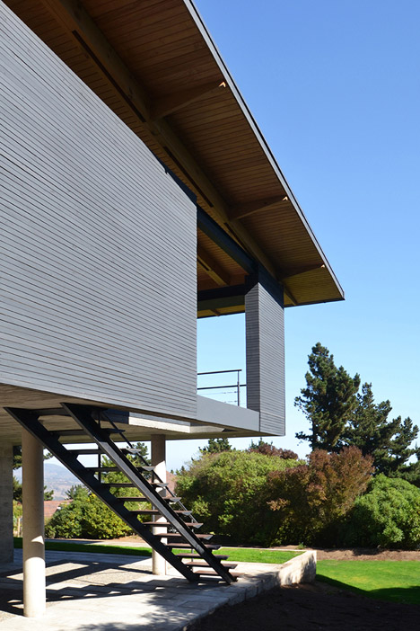 Timber-lined roof perches at an angle on top of Chilean seaside home