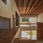 House in Japan designed by Kazuki Moroe to respect the shrine next door