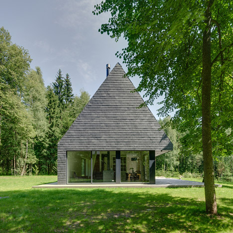 Aketuri Architektai clads woodland house&ltbr /&gt in Lithuania with shale tiles