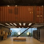 Shipping containers are suspended above shoppers inside Le Utthe boutique