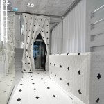 Wooden curtain drapes around a lift inside Maison Margiela's Milan store