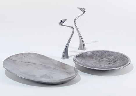 Metalware bowls and Swan candlesticks by Matthew Hilton