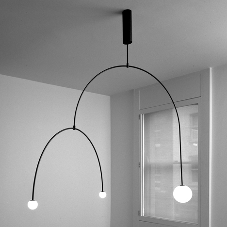 Michael Anastassiades creates minimal lighting designs from glowing spheres
