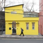 North Gate Salon fashion boutique features yellow walls and an Eames bird above the entrance