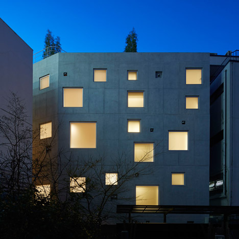 Florian Busch scatters square windows across the concrete facades of a Tokyo office