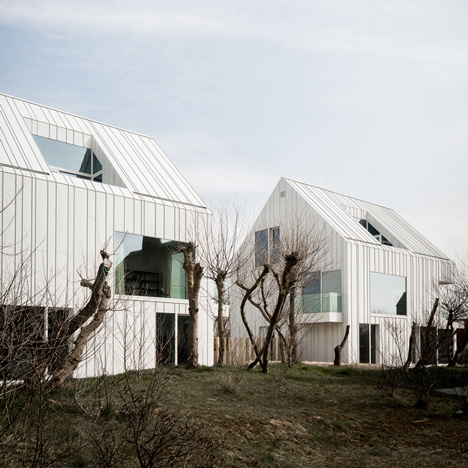 Homes near Belgium's coastline feature ridged skins of white aluminium