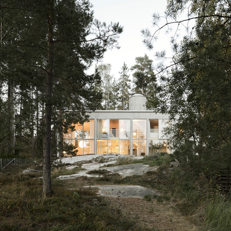 Concrete and glass house completed by<br /> Arrhov Frick in a Swedish woodland clearing