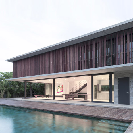 Slatted timber screens shade poolside residence in Thailand by Architectkidd