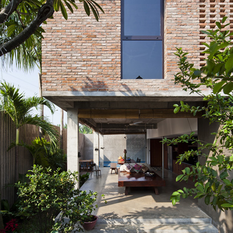 Vietnam house by MM++ Architects features a palm-leaf roof and an open-air living space