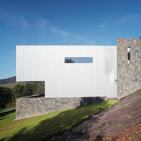 Villa in the Czech mountains combines perforated metal with stone gabions
