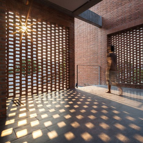 Brick grates set into the walls of a Bangkok&ltbr /&gt house hide a series of outdoor spaces