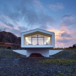 Beach House by Dualchas Architects stretches out towards the sea