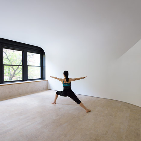 Curved walls confuse perception of space inside yoga studio by Clouds Architecture Office