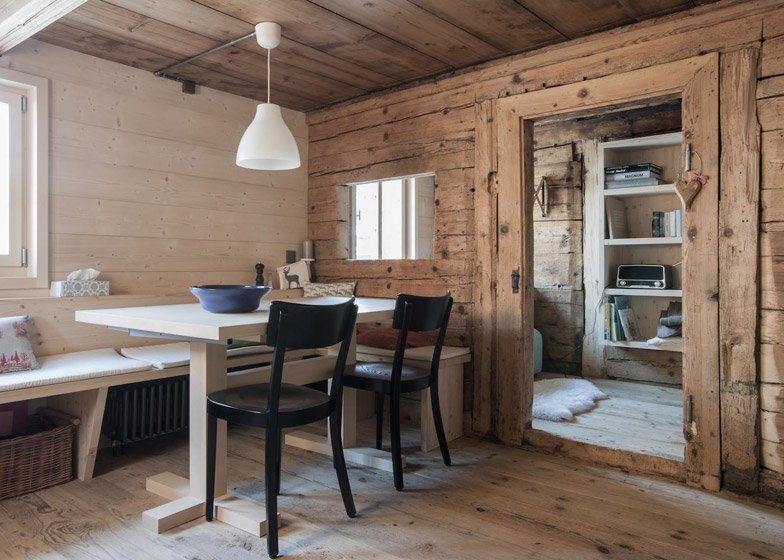Christian Müller converts an Alpine chalet into a pair of family apartments