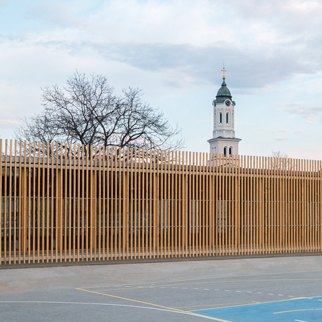 Jovan Mitrović wraps a glass-walled sports hall in protective timber battens