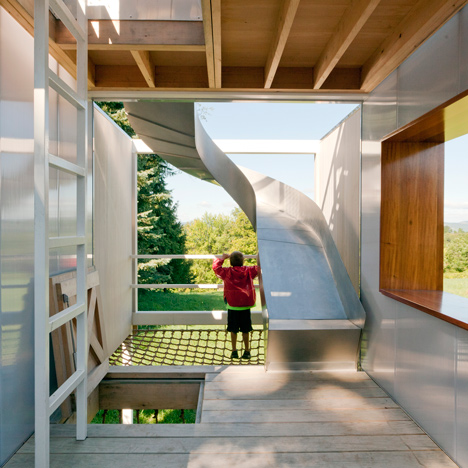 Playhouse on stilts by Sharon Davis features a slide, a climbing frame and a lookout point