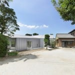 Architects Teehouse adds an angular steel-clad home to a Japanese dairy farm