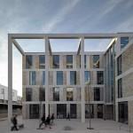 Concrete columns frame the entrance to John McAslan's Lancaster University building