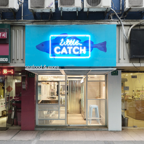 "Little Catch fishmonger in Shanghai is lined with a metal-frame ""net"""