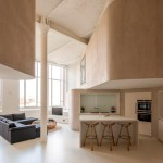 Graux & Baeyens uses curved walls to convert a factory loft into a family home