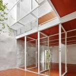 Arquitectura-G's Casa Luz features terracotta surfaces and a glazed courtyard