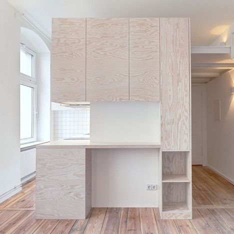 Pale Wooden Unit Frames Rooms And Creates A New Floor Inside Berlin Micro Apartment
