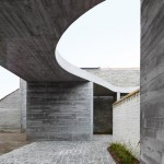 Concrete canopy creates two-storey terrace for home and clinic by Graux & Baeyens